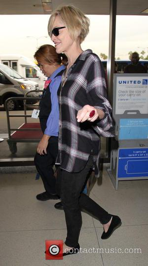 Sharon Stone - Sharon Stone departs on a flight from Los Angeles International Airport (LAX) - Los Angeles, California, United...