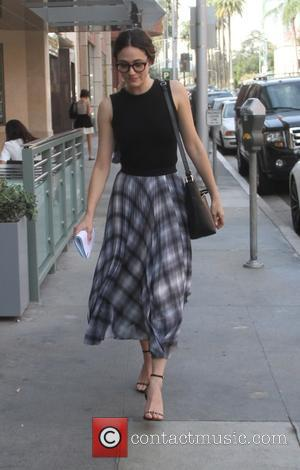 Emmy Rossum - Emmy Rossum wears a flowy plaid skirt and black framed glasses while out and about in Beverly...