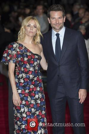 Sienna Miller , Bradley Cooper - European Premiere of Burnt at The Vue Leicester Square - London, United Kingdom -...