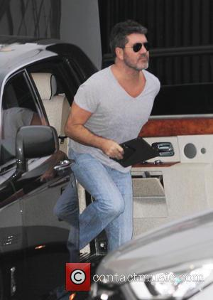 Simon Cowell - 'X Factor' contestants and judges arrive at live show rehearsals at x factor - London, United Kingdom...
