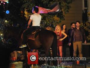 Zac Efron, Chloe Moretz, Seth Rogen , Rose Byrne - Zac Efron puts on his saddle for a scene in...