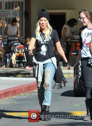 Tori Spelling - Tori Spelling, Dean McDermott, and their kids Hattie and Finn McDermott leave a school Halloween parade -...