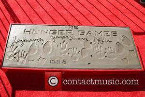 Josh Hutcherson, Jennifer Lawrence and Liam Hemsworth Hunger Games Handprints Footprints