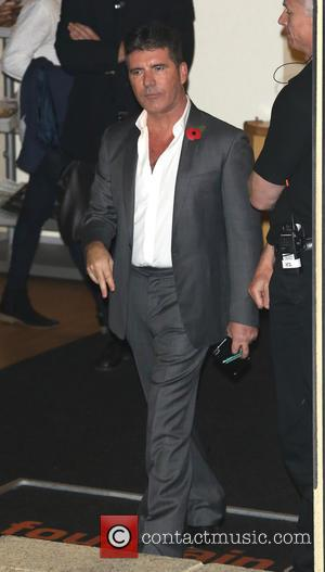 Simon Cowell - 'X Factor' judges and contestants leave the Fountain Studios after the first live show at x factor...