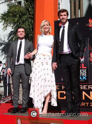 Josh Hutcherson, Jennifer Lawrence , Liam Hemsworth - 'The Hunger Games: Mockingjay, Part 2' cast hand and footprint ceremony at...