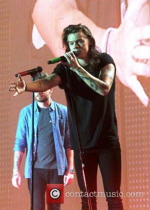 Harry Styles - One Direction play their last concert before a planned hiatus in Sheffield to adoring fans. - Sheffield,...