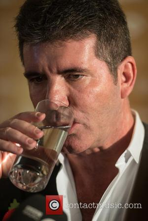 Simon Cowell and Head Shot