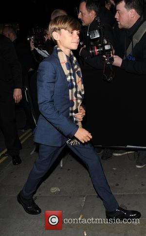 Romeo Beckham - Victoria Beckham and her two sons Cruz Beckham and Romeo Beckham were among the guests at a...