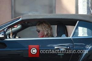 Melanie Griffith - Melanie Griffith parks her black Bentley before running an errand in Beverly Hills wearing a scarlet red...