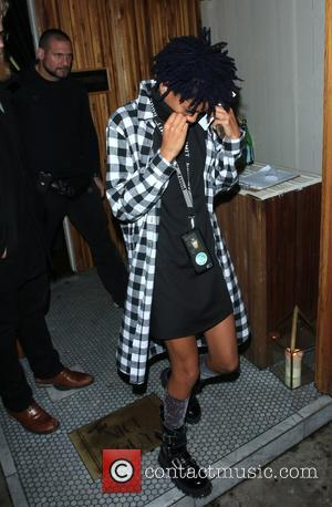 Willow Smith - Willow Smith covers her face with the neck of her sweater as she leaves The Nice Guy...