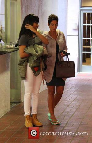 Nicole Murphy , Bria Murphy - Nicole and Bria Murphy passing some high heels after a pedicure in Beverly Hills...