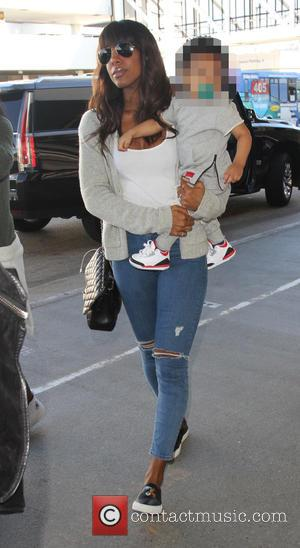 Kelly Rowland , Titan Jewell Witherspoon - Kelly Rowland carries her in her son in her arms as they depart...