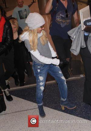 Kristin Chenoweth - Kristin Chenoweth arrives at Los Angeles International Airport (LAX) wearing ripped jeans, sunglasses and a pair of...