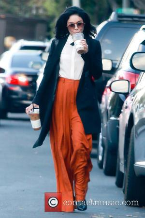Vanessa Hudgens - Vanessa Hudgens was spotted leaving Alfred Cafe in Beverly Hills wearing orange baggy trousers - West Hollywood,...