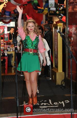 Kimberley Walsh - Elf the musical cast attend children's toy store to unveil their Christmas window and perform songs from...