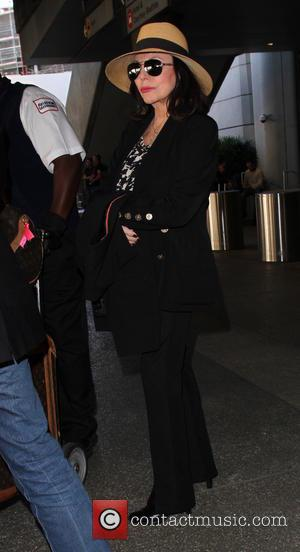 Joan Collins - Joan Collins arrives on a flight to Los Angeles International Airport (LAX) - Los Angeles, California, United...