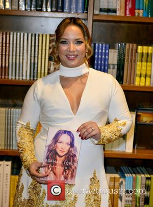 Adamari Lopez - Adamari Lopez greets fans and signs copies of her new book 'Amando' at Books And Books at...