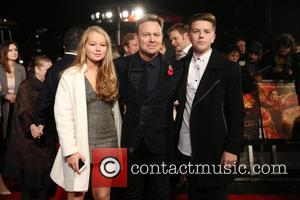 Jason Donovan, Son , Daughter - The Hunger Games: Mockingjay - part 2 - UK film premiere held at the...