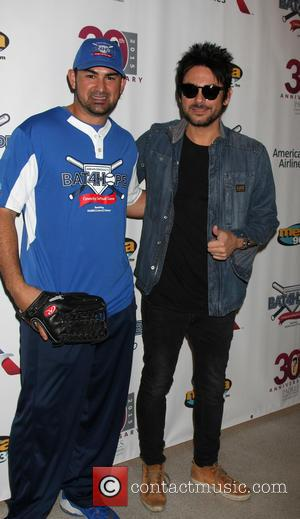 Adrian Gonzalez and Beto Cuevas
