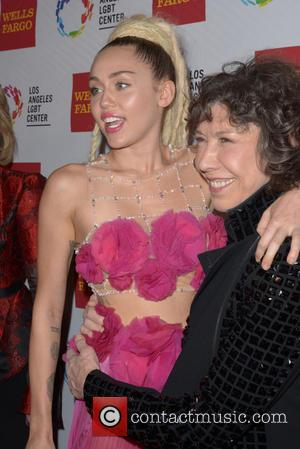 Miley Cyrus and Lily Tomlin