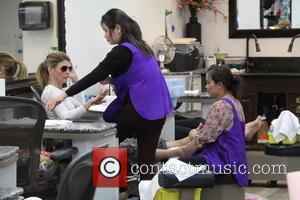 Lori Loughlin - Lori Loughlin keeps her sunglasses on while she gets a manicure and pedicure at a nail salon...