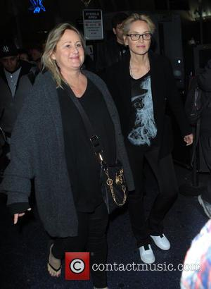 Sharon Stone , Kelly Stone - Sharon Stone wearing a black t-shirt with 'Where There Is Smoke, There Is Fire'...