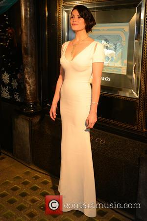 Gemma Arterton - Actress Gemma Arterton unveils the Tiffany Christmas windows of the London Old Bond Street store - London,...