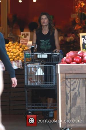 Elisabetta Canalis - Elisabetta Canalis showing off her arm tattoo wearing a sleevless t-shirt for Krav Maga, the official hand-to-hand...