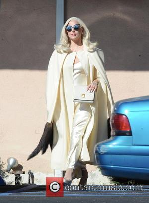 Lady Gaga - Lady Gaga spotted dancing around in a sexy white silk dress for a scene in 'American Horror...