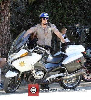 Dax Shepard - Actor Dax Shepard hits the street of Los Angeles as highway patrolman Jon Baker with co star...