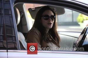 Emmy Rossum - Emmy Rossum picks up lunch at at drive-thru at beverly hills - Beverly Hills, California, United States...