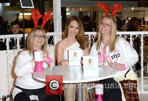 Katie Piper - Katie Piper signs copies of her book 'Start Your Day With Katie' at the Ideal Home Show...