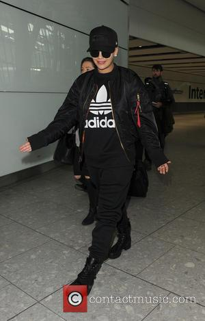 Rita Ora - Rita Ora arriving at Heathrow Airport on a flight from berlin. Rita was wearing one of her...