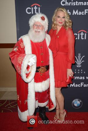 Santa Claus and Molly Sims