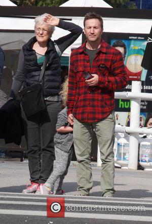 Breckin Meyer , Clover Meyer - Breckin Meyer crosses a busy street while out and about with his daughter in...