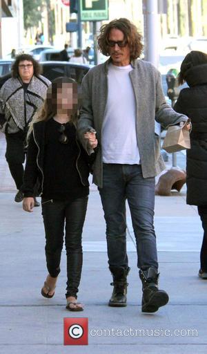 Chris Cornell , Toni Cornell - American rock musician Chris Cornell out and about in Beverly Hills with his daughter...