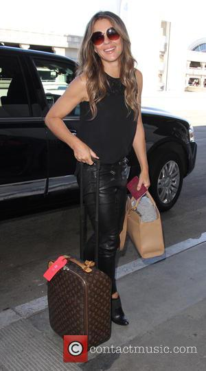 Elizabeth Hurley - Elizabeth Hurley departs on a flight from Los Angeles International Airport (LAX) - Los Angeles, California, United...