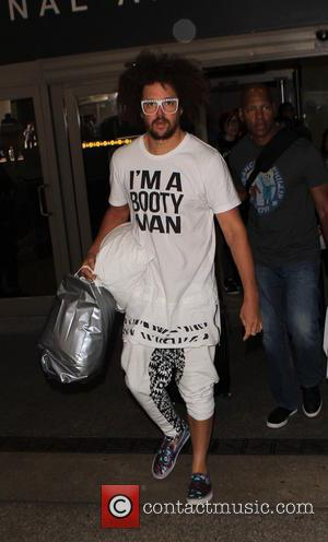 Redfoo - Redfoo at Los Angeles International Airport (LAX) wearing a Tshirt with the slogan 'I'm a booty man' and...
