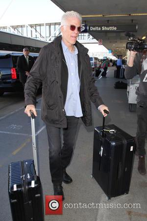Ted Danson - Ted Danson arrives on a flight to Los Angeles International Airport (LAX) with his actress wife Mary...