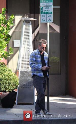 Matthew Perry - Matthew Perry seen using his phone whilst he wait for his Audi car at beverly hills -...
