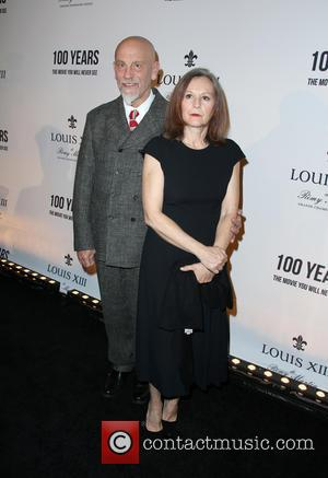 John Malkovich and Nicoletta Peyran