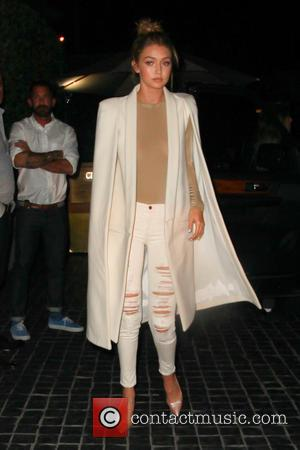 Gigi Hadid - Gigi Hadid wearing white torn jeans and white cape, out for dinner at Cecconi's in Beverly Hills...