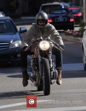 Keanu Reeves - Keanu Reeves riding his motorbike with a silk scarf flying in the wind at beverly hills -...