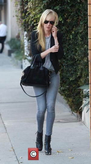 Kimberly Stewart - Kimberly Stewart leaving a hair salon in Beverly Hills in black boots and skinny jeans - Beverly...