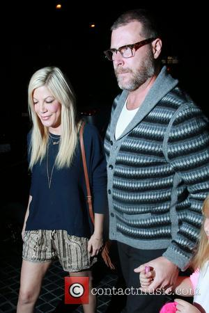 Tori Spelling , Dean Mcdermott - Tori Spelling and her husband Dean Mcdermott arrive at Cecconi's restaurant with their daughter...