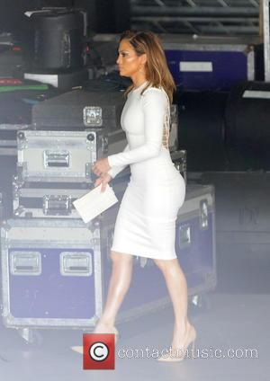 Jennifer Lopez - Jennifer Lopez shows off her famous curves in a tight white dress for the filming of Hollywood...
