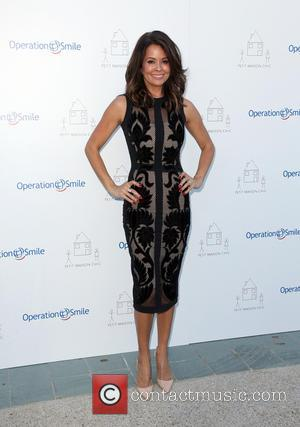 Brooke Burke-Charvet - Petit Maison Chic and Operation Smile Kids Charity Fashion Show at Beverly Hills - Beverly Hills, California,...