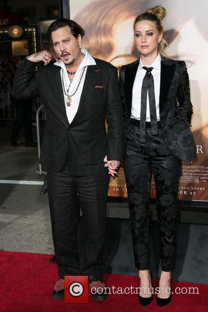 Johnny Depp , Amber Heard - Los Angeles premiere of Focus Features' 'The Danish Girl' - Arrivals at Westwood Village...