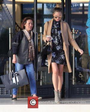 Chrissy Teigen - Pregnant Chrissy Teigen shopping at Barneys New York in Beverly Hills wearing a camel coat at beverly...