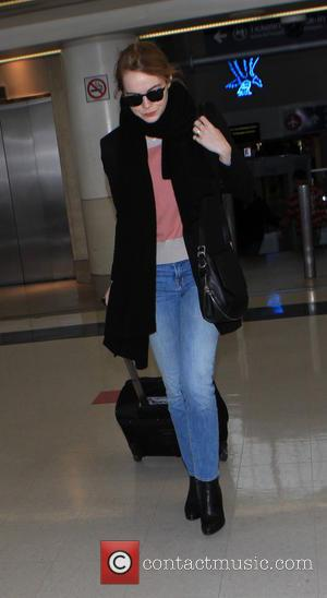 Emma Stone - Emma Stone departs on a flight from Los Angeles International Airport (LAX) - Los Angeles, California, United...